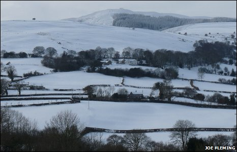 A snowy scene looking towards Moel Famau from Pantymwyn