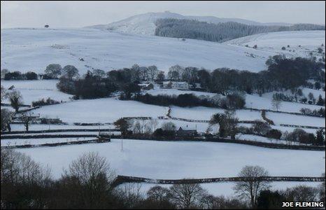 A snowy scene looking towards Moel Famau from Pantymwyn