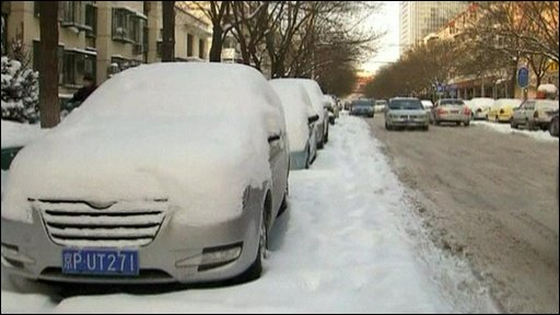 Car covered in snow in Beijing
