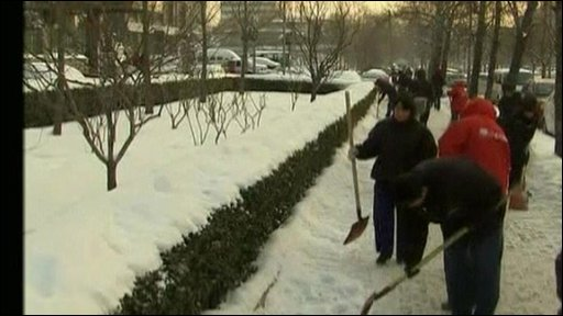 People try to clear the snow