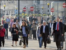 Commuters walk to work in London