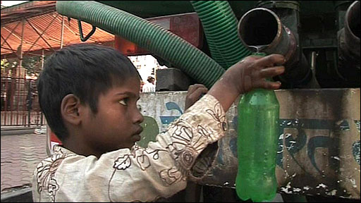 Boy filling bottle