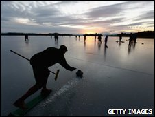 Curlers play a match on the frozen Lake of Menteith, Scotland on 4 January 2010