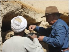 Archeologists near the entrance to the tomb