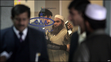 A man is searched at Islamabad's airport (4 January 2010)