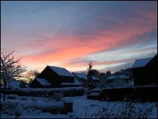Sunset over snowed under street