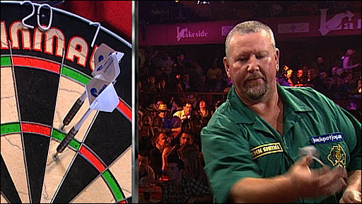 Australia's Tony Fleet drops his dart in his first-round match against Martin Adams