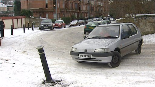 Motorist sliding on ice
