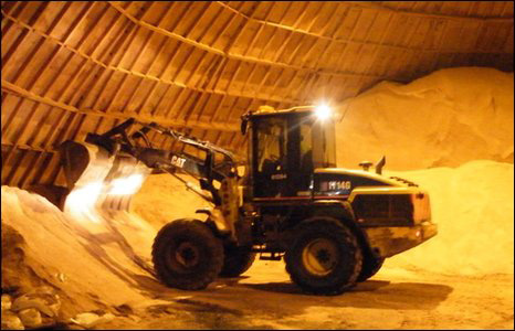 The tractor re-fills gritter trucks from salt in the snow dome
