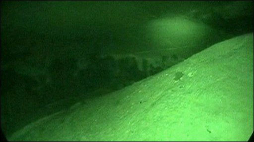 Still from helicopter night vision camera during rescue