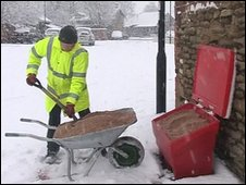 Man filling grit box in Market Weighton