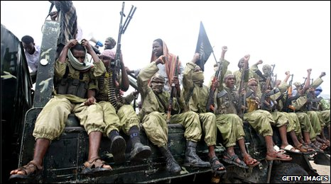 Hardline Islamist fighters from Al-Shabab chant slogans as they rally in the streets of Mogadishu on October 30, 2009
