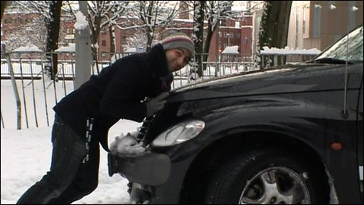 Ricky tries to push a car stuck in the snow