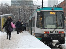 A tram in the snow in Manchester