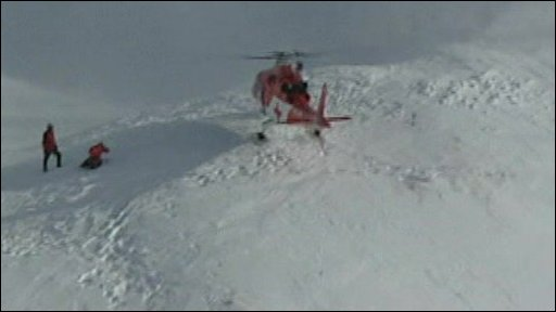 Helicopter hovers over site of avalanche