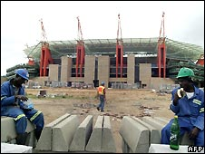 Workers put finishing touches to the Nelspruit World Cup stadium
