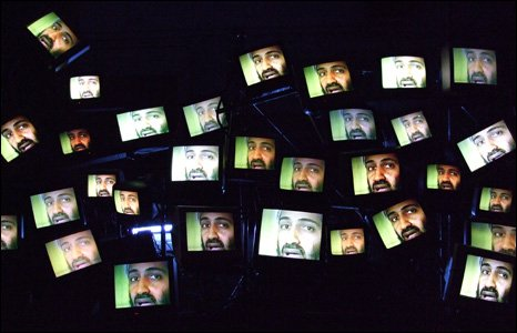 Screen showing the face of Osama Bin Laden