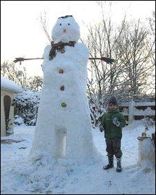 Child building a 9ft snowman