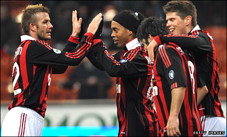 David Beckham celebrates Milan's fifth goal with his team-mates