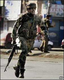 Indian paramilitary soldier during a stand-off with militants in Srinigar, 6 January 2010
