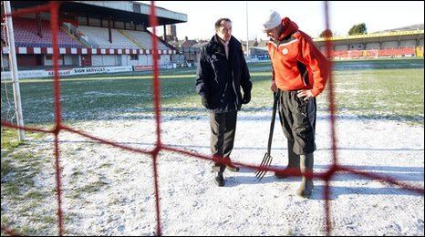 Cliftonville groundsman John Rogan (right) and referee Keith Halliday at a frozen Solitude