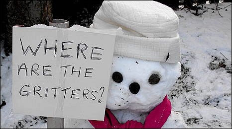 Snowman with gritter placard