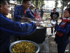 Former child soldiers get food in their camp in Dudhauli
