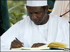Umaru Yar'Adua signs a register after his swearing-in as Nigeria's president on 29 May 2007
