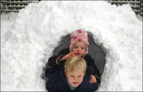 An Igloo with two children.