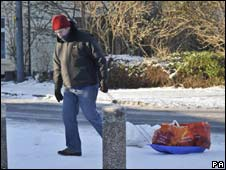Man drags his shopping home on a sledge in Bristol