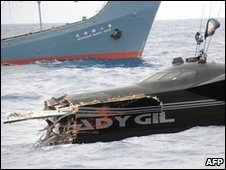 The Ady Gil with its bow sheared off after its collision with the Shonan Maru 2, background - 6 January 2010