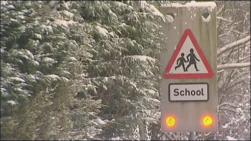 School road sign in snow