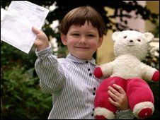 Arran Fernandez with his teddy bear Pudsey after he became the youngest person to pass a GCSE.