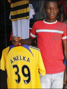 A young boy in Bouake sellsA football shirt for Chelsea striker Nicolas Anelka