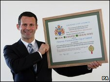 Ryan Giggs with his award