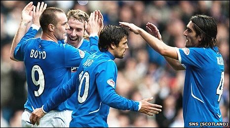 Kris Boyd (l) with fellow Rangers players Kirk Broadfoot, Nacho Novo and Pedro Mendes