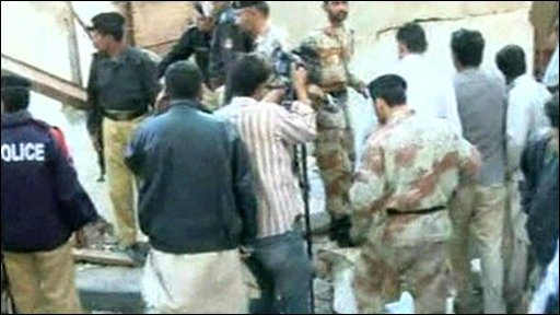 Crowds around the site of the explosion in Karachi