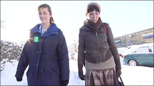 Nurses walk through snow to reach patients