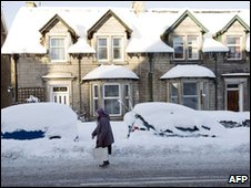 A woman walks in the snow in Hawick, in Scotland