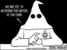 Cartoon showing hooded KKK-like figure with Victoria Police badge - image from Mail Today