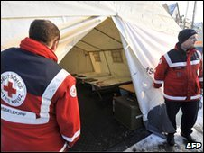 Red Cross workers prepare heated tents for homeless people in the western German city of Duesseldorf, 7 December 2010