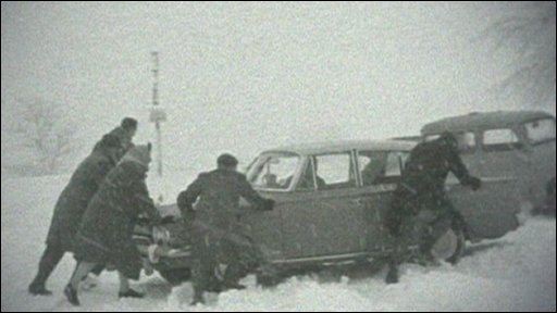 pushing a car in the snow in 1963