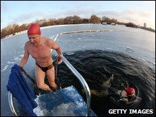 People swimming in a hole in the frozen Serpentine lake in Hyde Park