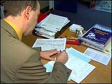 head teacher doing paperwork