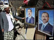 A Yemeni looks at posters of President Ali Abdullah Saleh at a market in Sanaa