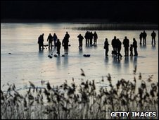 Curlers from the Port of Menteith curling club play a match on the Lake of Menteith