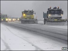 Snowploughs clearing a road near Lyon in France