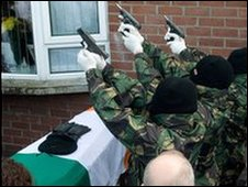 Masked men fire shots at funeral