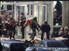 Russian army bringing the injured out from the theatre that was besieged by Chechen rebels in 2002