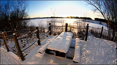 Image by Stuart Ladd showing the frozen lake at the Llyn Llech Owain Nature Reserve in Gorlas, Carmarthenshire.